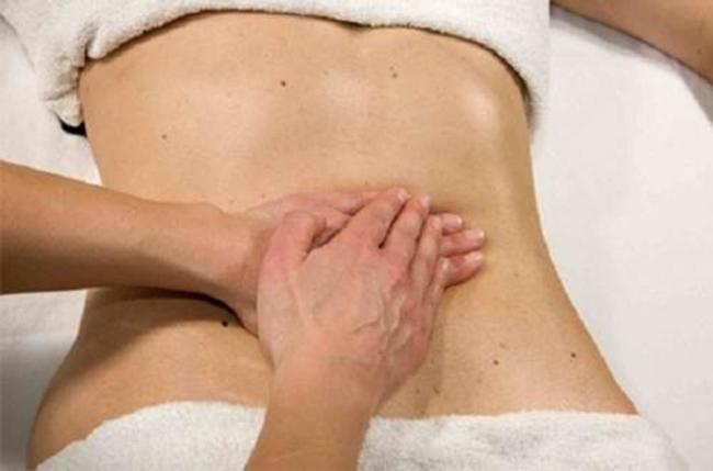 abdomen and gently massage your hands.