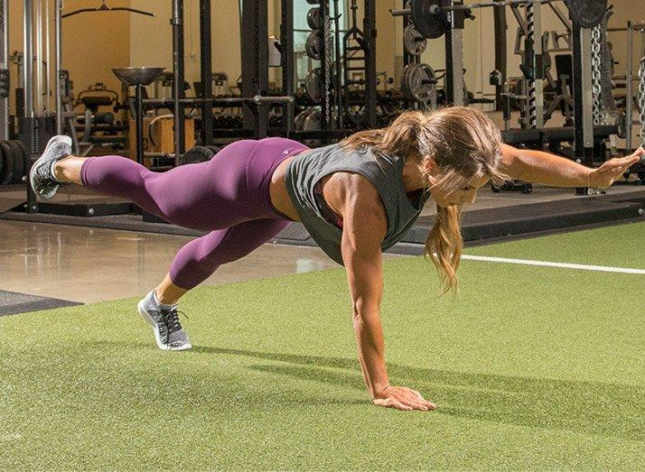 Alternating arm-and-leg raise from plank