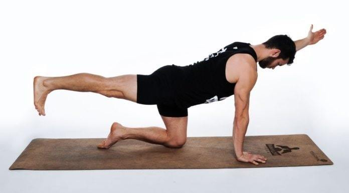 Exercise to reduce male abdominal fat, lifting arms and legs sideways
