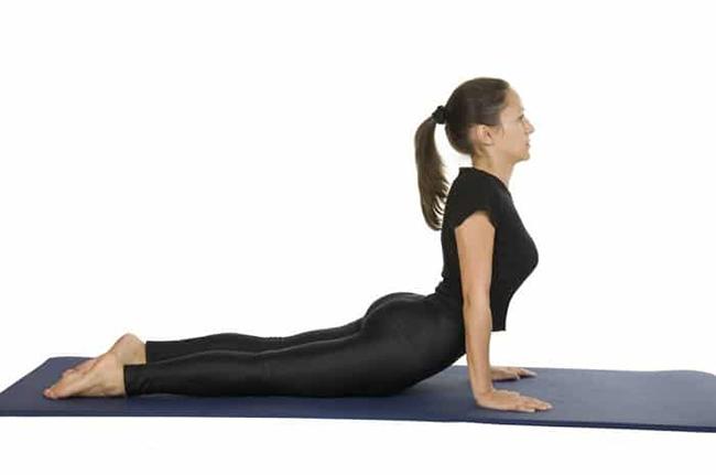 Doing yoga at home with cobra pose (Cobra Pose)