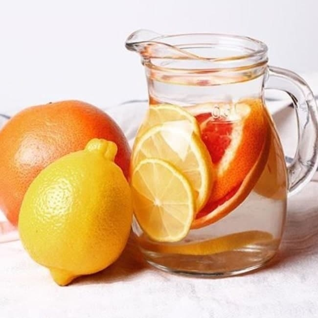 Detox drink with orange and soup.