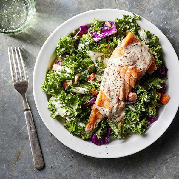 Salad with vegetables and 450g salmon fillet served with sauce