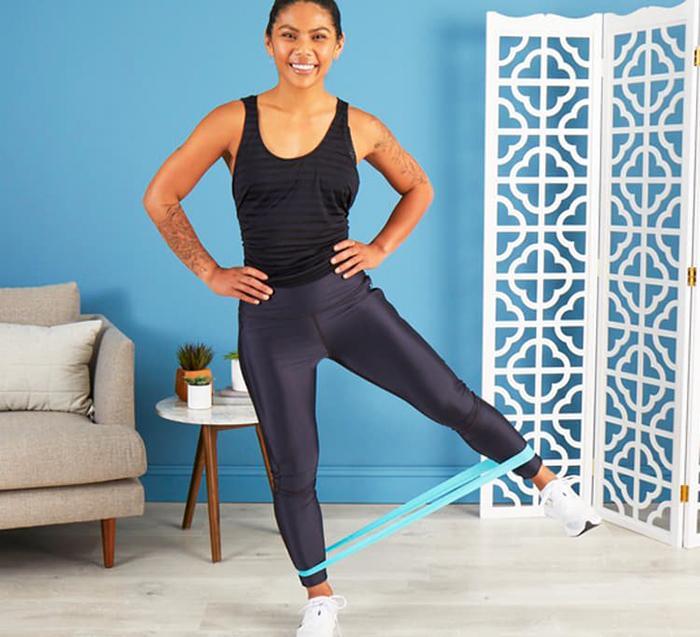 Banded lateral leg raise squat