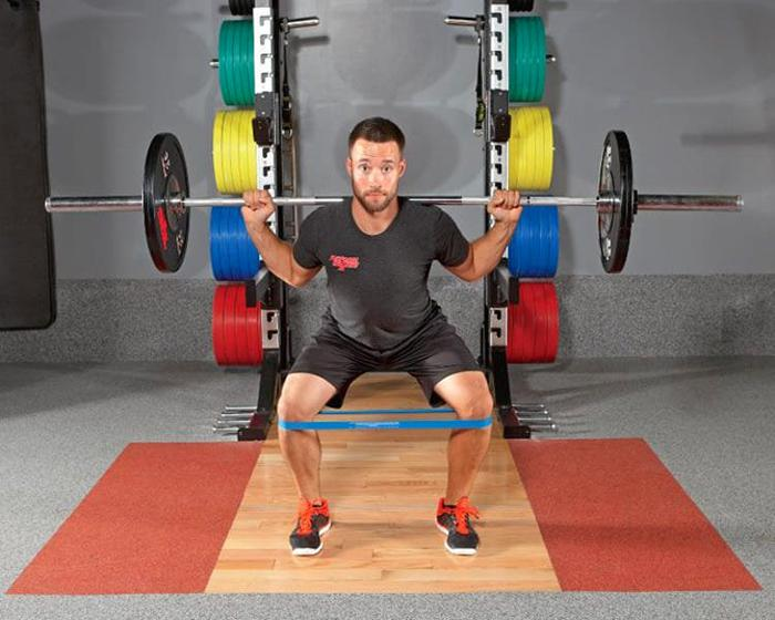 Barbell banded squat