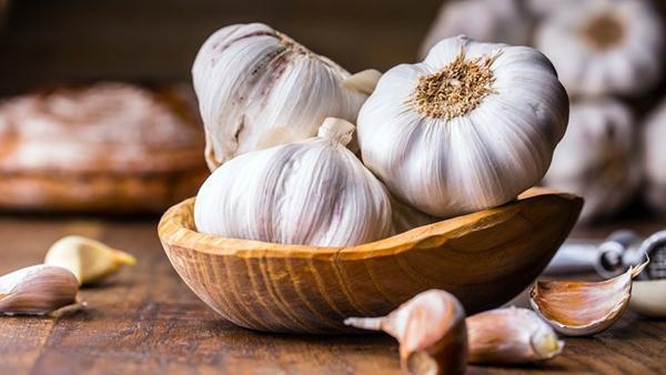 Add garlic to dishes