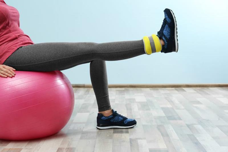 Stretching exercises with ankle dumbbells